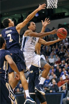 Old Dominion University's Trey Freeman, center, drives to the basket past Charleston Southern's Aaron Wheeler, left, and Wesley Johnson, background, during the first round of the NIT tournament Wednesday evening at the Constant Center in Norfolk. (Jonathon Gruenke)