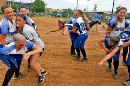 Christopher Newport University players try to pass the time while in a rain delay during Sunday's NCAA Division III regional tournament championship against Randolph-Macon on May 10, 2015.