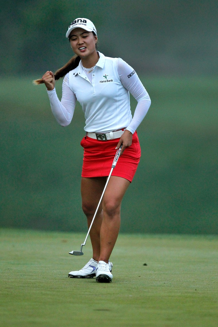 Minjee Lee celebrates after making a putt on the 15th hole to put her at 16 under during the final round of the LPGA Kingsmill Championship on May 17, 2015.