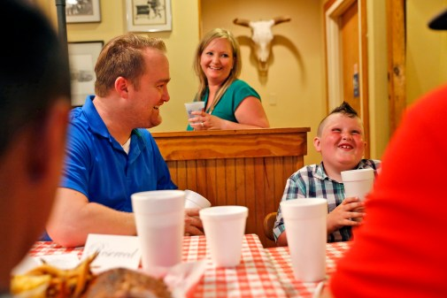 Kyle Summerfield, right, laughs while talking with Albert Kurtyka, left, and Leora Kurtyka, center, Friday evening at Beach Bully Bbq in Virginia Beach. Albert Kurtyka received the heart of Summerfield's father, William, 34, after he died in a car accident in January 2014.
