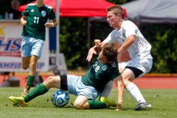 Jamestown's Wilson Coughenour, right, battles for control of the ball with Hanover's Reece Theakston during Saturday's 4A state championship soccer game at Liberty University in Lynchburg.