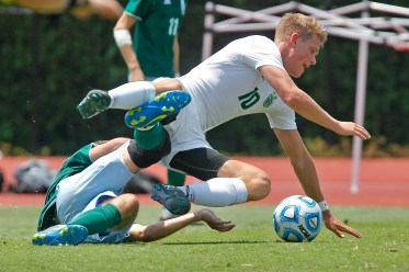 Jamestown's Davis Wood, right, collides with Hanover's Cole Farnsworth during Saturday's 4A state championship soccer game at Liberty University in Lynchburg.