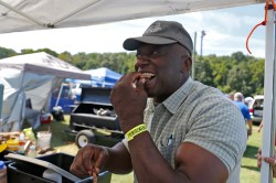 Arn Stuart samples a piece of brisket during Saturday's Southern Fried Festival at Langley Speedway. The event featured a barbecue competition, car show and live music.