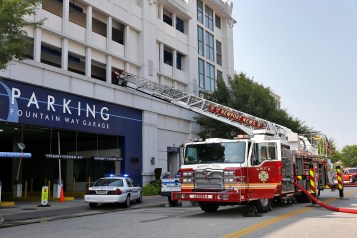 Newport News police and firefighters respond to the scene of fire inside the parking structure on Mariners Row in City Center Thursday afternoon. (Photo by Jonathon Gruenke/Daily Press)