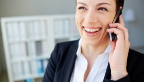 close-up-of-smiling-woman-with-mobile-phone_1098-3135