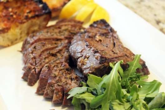 Serve steak sliced with arugula