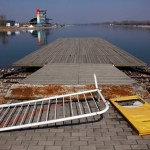 An old Olympic accreditation board lies on an unmaintained jetty at the deserted former venue for the 2008 Beijing Olympic Games rowing competition. Picture: REUTERS/David Gray