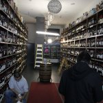 A wine shop in Lower Manhattan uses a generator for some light.