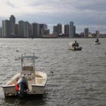 Boats moored elsewhere float in Hudson River after being displaced by Hurricane Sandy.