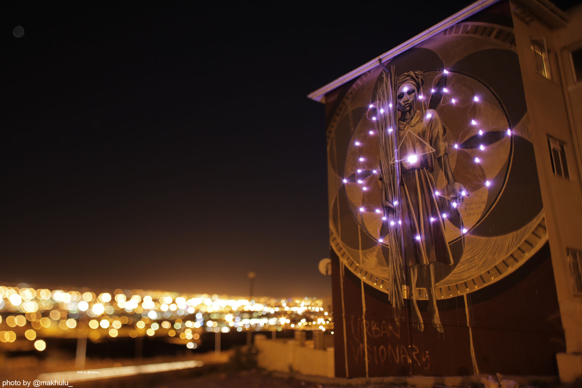 The mural lights up every time a new streetlight is erected. Photo by @makhulu