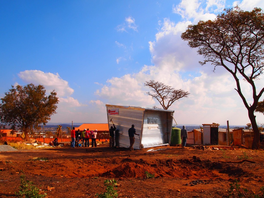 Mamelodi Pod, a home and temporary soccer club with solar electricity and rain water harvesting. Image Courtesy of Architecture for a Change