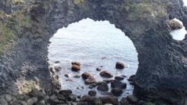 rock arch near ocean