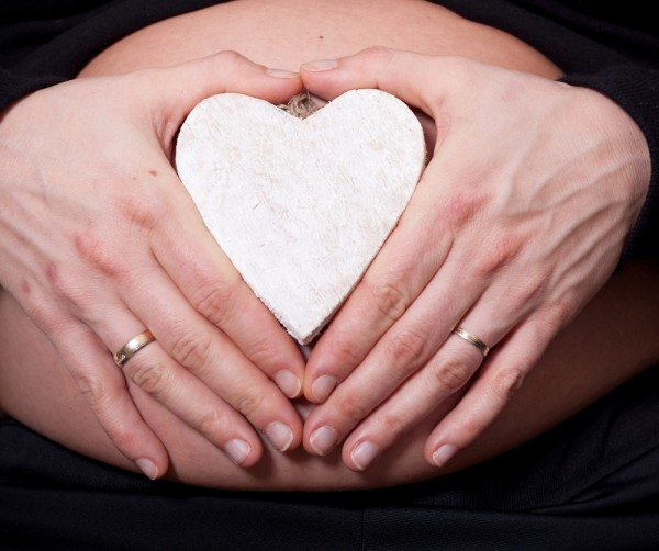 pregnant belly with a heart