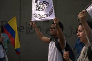 """""""Rebellion is justice.""""   A protest demanding the reinstatement of the mayor of Bogotá, 10 January 2014."""