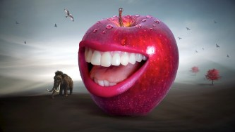 Huge red apple with teeth is smiling next to a smaller wooly mamoth
