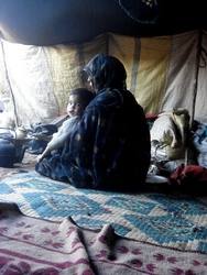 Inside a nomad tent at Chegaga, with baby Hassan