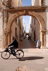 A cyclist inside Essaouira's medina