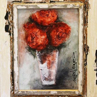 framed painting with three red flower in a white vase