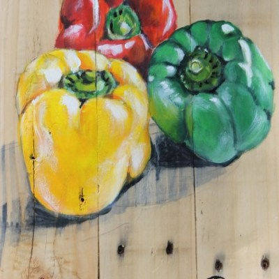 Painting of red, green and yellow peppers done on wood