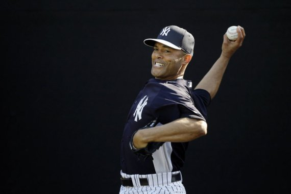 New York Yankees relief pitcher Mariano Rivera (42) celebrates the win with catcher Chris Stewart (19) against the Toronto Blue Jays at Yankee Stadium. Yankees won 3-2. (Anthony Gruppuso-USA TODAY Sports)