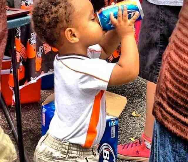 Little kid drinking beer at cleveland browns tailgate