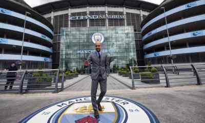 """Manchester City's Spanish football coach Pep Guardiola poses for photographs outside the Etihad Stadium in Manchester, northern England, on July 8, 2016. Pep Guardiola has warned his Manchester City players that they have to prove themselves all over again following his arrival at the club. / AFP PHOTO / OLI SCARFF / RESTRICTED TO EDITORIAL USE. NO USE WITH UNAUTHORIZED AUDIO, VIDEO, DATA, FIXTURE LISTS, CLUB/LEAGUE LOGOS OR """"LIVE"""" SERVICES. ONLINE IN-MATCH USE LIMITED TO 45 IMAGES, NO VIDEO EMULATION. NO USE IN BETTING, GAMES OR SINGLE CLUB/LEAGUE/PLAYER PUBLICATIONS.OLI SCARFF/AFP/Getty Images"""