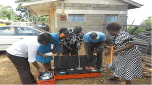 Staff members inspecting leak detection machine at Nyakianga Headquarter Office