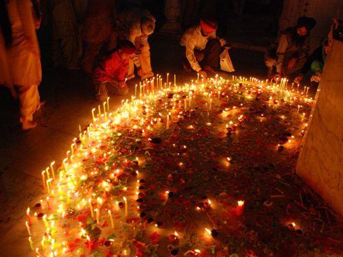 Lighting Lamps for Diwali in India