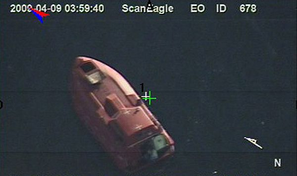 (April 9, 2009) In a still frame from video released by the U.S. Navy taken by the Scan Eagle unmanned aerial vehicle, the 28-foot lifeboat holding Captain Phillips and his captures is seen Thursday, April 9, 2009 in the Indian Ocean. (U.S. Navy Photo)