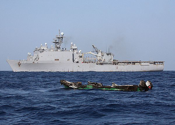 Suspected pirates skiff drifts at sea after being burnt the amphibious dock landing ship USS Ashland (LSD 48). U.S. Navy photo, by Chief Fire Controlman Harry J. Storms