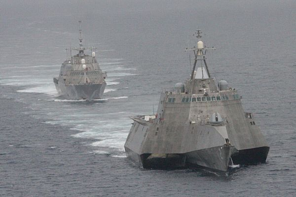 The first of class littoral combat ships USS Freedom (LCS 1), rear, and USS Independence (LCS 2) maneuver together during an exercise off the coast of Southern California. Photo: U.S. Navy