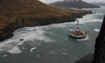 Shell's 2012 failed arctic drilling campaign culminated in the Kulluk drilling rig running aground in Alaska after breaking free from during a tow to Washington. U.S. Coast Guard Photo