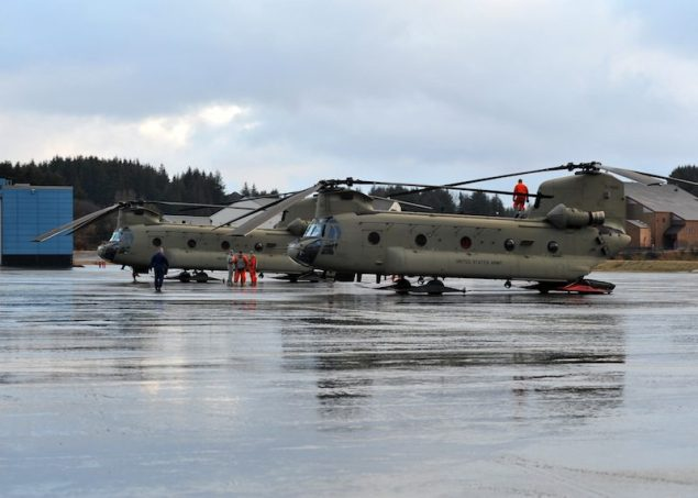 Two CH-47 Chinook helicopters from the Army 16th Combat Aviation Brigade, out of Ft. Wainwright, Alaska, land at Air Station Kodiak, Friday, Jan. 4, 2012. Members of the 16th Combat Aviation Brigade are in Kodiak to assist with the lift and transportation of heavy equipment that will be moved to the Kulluk to assist with the salvage of the conical drilling unit. U.S. Coast Guard photo by Petty Officer 3rd Class Jonathan Klingenberg.