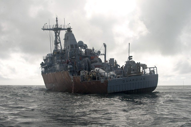 SULU SEA (Feb. 8, 2013) The mine countermeasures ship USS Guardian (MCM 5) sits aground on Tubbataha Reef, a UNESCO World Heritage site. U.S. Navy  Photo