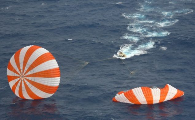 Dragon spacecraft and two of the three main parachutes shortly after splashdown, May 31, 2012. Courtesy NASA