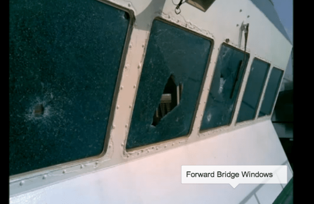 Bullet holes in the forward bridge windows.