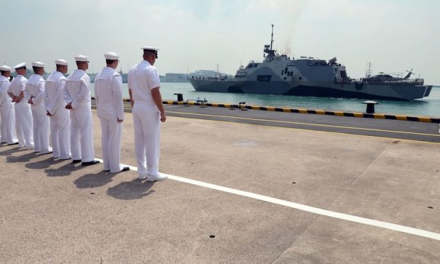 SINGAPORE (April 18, 3013) Sailors attached to Forward Liason Element, USS Freedom (LCS 1), observe Freedom as it arrives in Singapore during an eight-month deployment to Southeast Asia. US Navy Photo