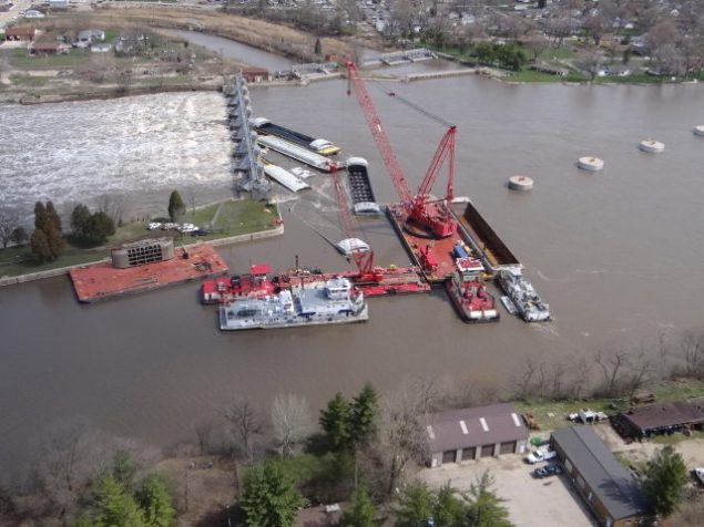 """A crane known as the """"HERCULES"""" unloads cargo from one of the submerged barges near the Marseilles Dam in Marseilles, Ill., April 24, 2013. Read more: http://www.dvidshub.net/image/915358/salvage-operations-continue-near-marseilles-dam#.UXqrqytATeo#ixzz2Rab8z2xX"""