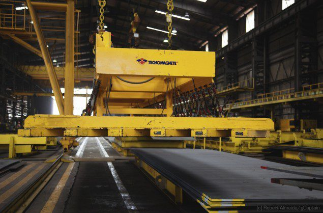 Electromagnets on gantry cranes move plates of steel around. (c) R.Almeida/gCaptain
