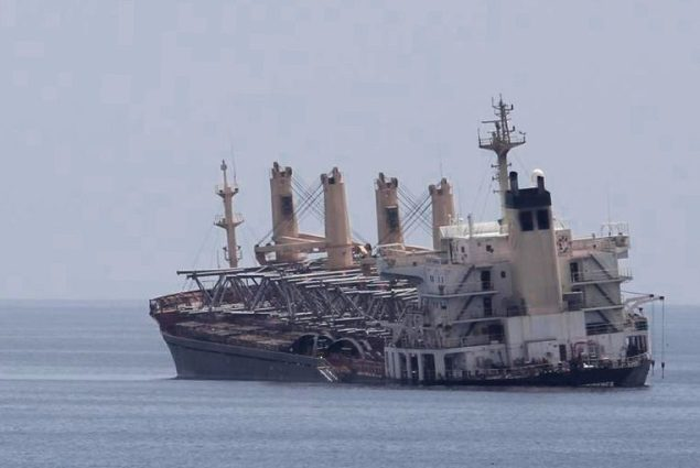 M/V Atlantic Confidence seen partially sunk off the coast of Oman on March 30, 2013. Photo: NATO Task Force