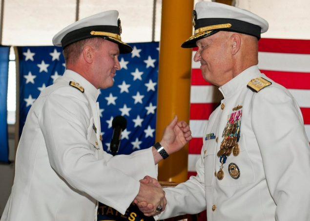 Rear Adm. T. K. Shannon (left) and Rear Adm. Mark Buzby congratulate each other during a change of command ceremony aboard the USNS Spearhead (JSHV 1). Shannon relieved Buzby as commander, Military Sealift Command. U.S. Navy Photo by Mass Communication Specialist Seaman Apprentice Jesse A. Hyatt