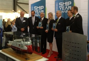 CEO in Ulstein Group, Gunvor Ulstein, and Managing Director in Ulstein Design & Solutions, Sigurd Viseth, (no. 4 and 5 from left) were presented with the 'Ship of the Year 2013' award for the IMR vessel 'Seven Viking' at Nor-Shipping. Photo credit: Ulstein