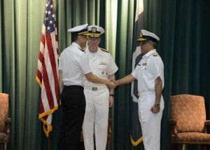 Rear Admiral Giam Hock Koon from the Republic of Singapore Navy (RSN) hands over command of CTF 151 to Commodore Muhammad Ihsan Qadir.