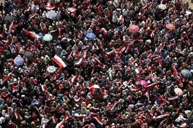 Protesters, who are against Egyptian President Mohamed Mursi, gather in Tahrir Square in Cairo July 3, 2013. Egyptian troops with armoured vehicles have secured the central Cairo studios of state television on Wednesday, security sources said. As a deadline approaches when the army high command is expected to step in and reorder Egypt's political institutions, the sources said staff not involved in working on live broadcasts had left the building. REUTERS/Steve Crisp