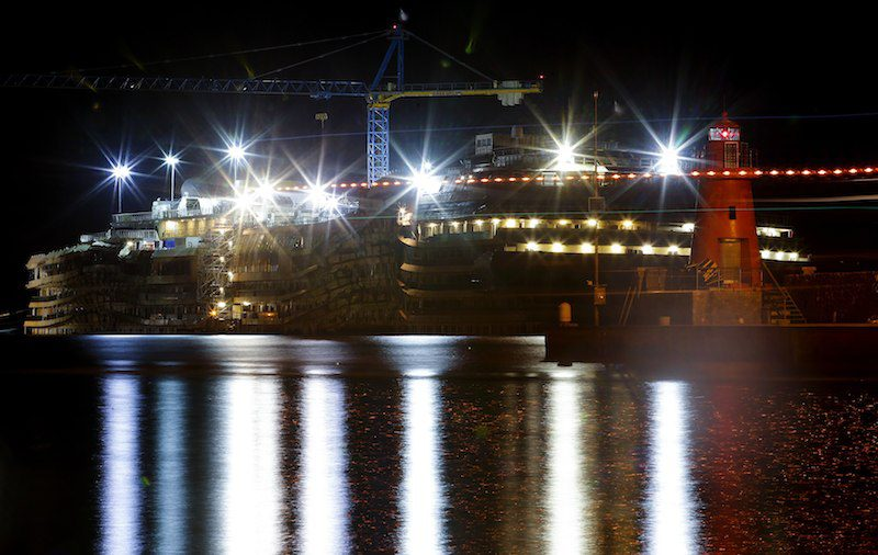 "The cruise liner Costa Concordia is seen during the ""parbuckling"" operation outside Giglio harbour January 11, 2014. REUTERS/Max Rossi"