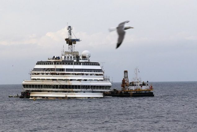 The cruise liner Costa Concordia is seen outside Giglio harbour February 26, 2014. REUTERS/Alessandro Bianchi