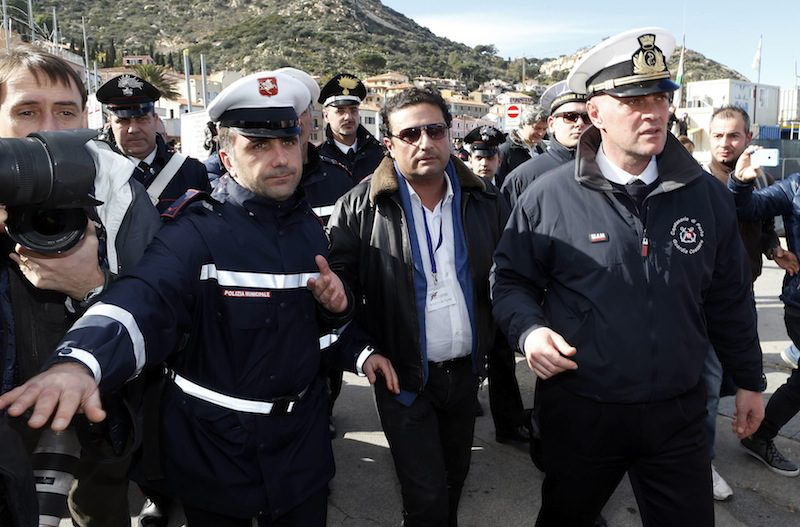 Francesco Schettino (C), the captain of the Costa Concordia, after going back on board the Costa Concordia cruise liner with investigators, February 27, 2014. REUTERS/Alessandro Bianchi