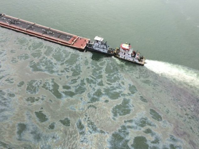 A tank barge leaks fuel oil following a collision with a bulk carrier, March 22, 2014. U.S. Coast Guard Photo