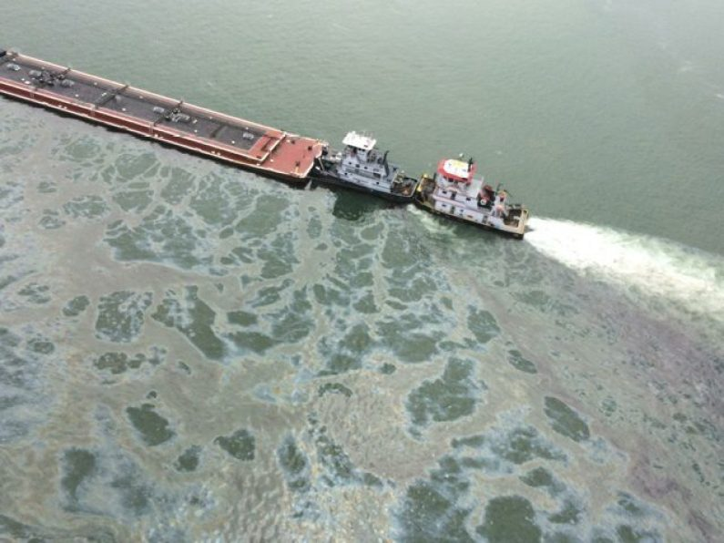 A tank barge leaks fuel oil following a collision with a bulk carrier, March 22, 2014 in the Houston Ship Channel. U.S. Coast Guard Photo