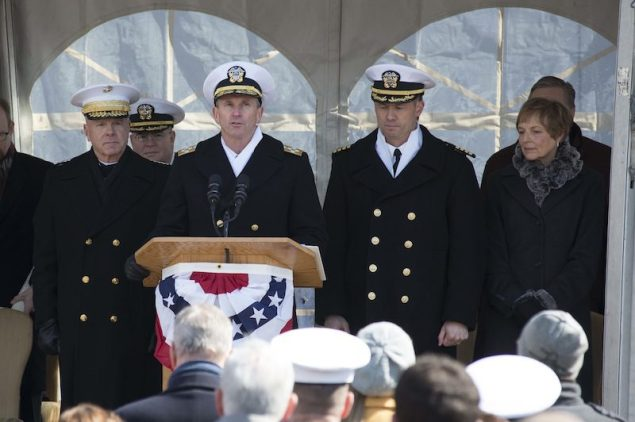 140301-N-WL435-400 PHILADELPHIA (March 1, 2014) Chief of Naval Operations (CNO) Adm. Jonathan Greenert is joined at the podium by Commandant of the Marine Corps Gen. James Amos, USS Somerset (LPD 25) Commanding Officer Capt. Thomas Dearborn and ship's sponsor Mary Jo Myers as he gives to order to place Somerset in commission during the commissioning ceremony of the San Antonio class amphibious transport dock March 1. U.S. Navy Photo